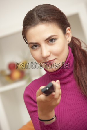 happy woman watching television