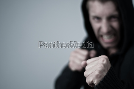 aggressive young man in boxing position