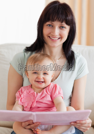 beautiful woman holding her baby and