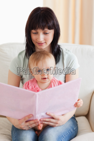 attractive woman holding her baby and