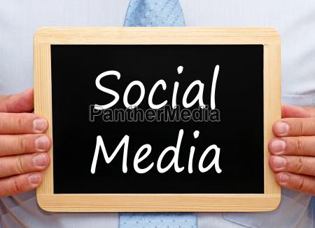 social media man with chalkboard
