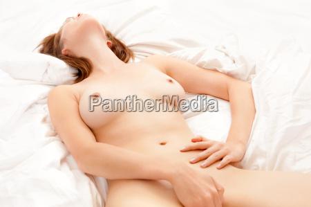 beautiful nude woman loving herself