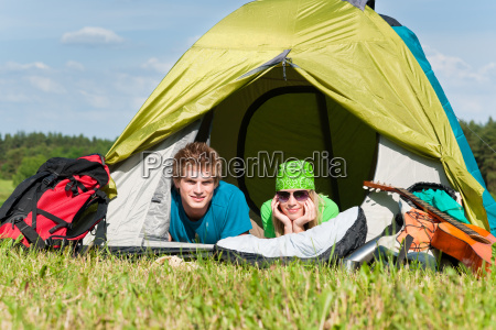 camping couple lying inside tent summer