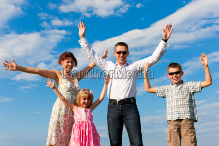 happy family on a meadow in