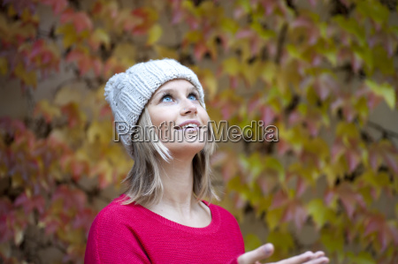 young woman in front of autumn