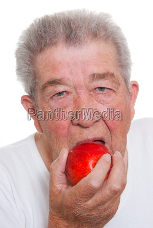 senior biting into an apple