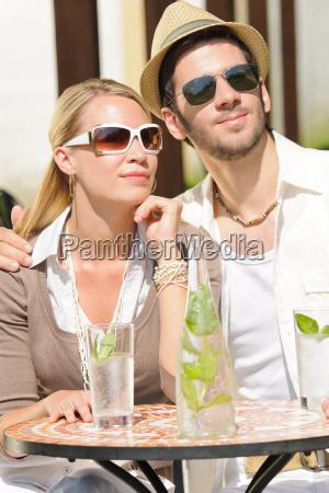 restaurant terrace elegant couple drink
