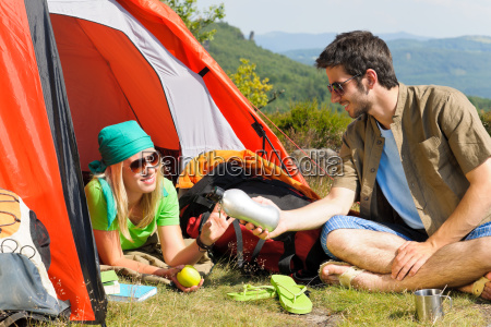 camping young couple with tent summer