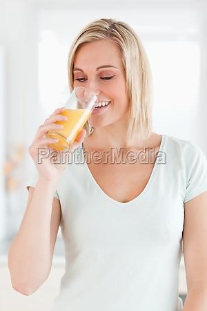 charming woman drinking orange juice