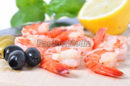 shrimps olives lemon and basil on