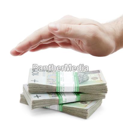 polish money and hand on white