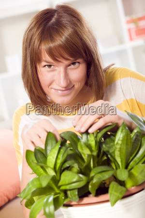 woman with home plants