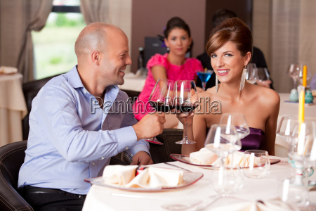 young couple toasting restaurant table