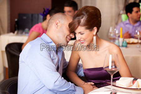 young couple flirting at restaurant table
