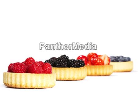 raspberries in tartlet cake in front