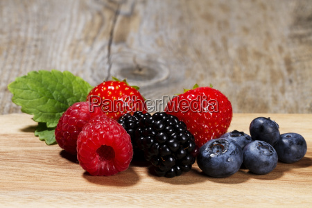 wild berries on wooden background