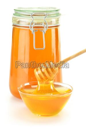 komposition mit schuessel mit honig und