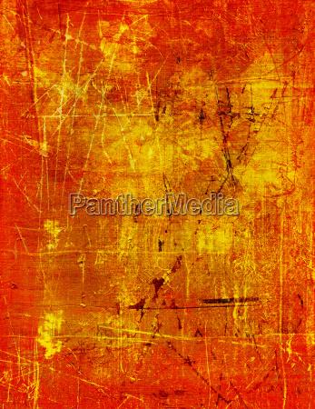 goldfarbe auf holzplatte zerkratzt