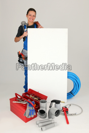 female plumber with tools of the