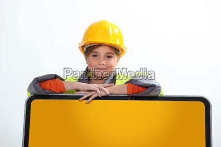little girl in construction uniform