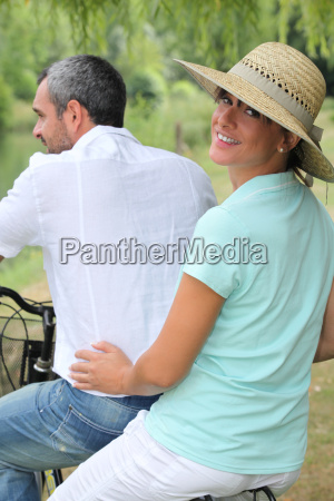couple riding on a bike together