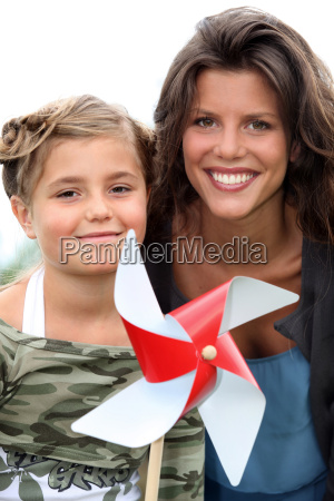 mother and daughter with a windmill