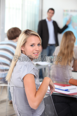 female student sitting in a geography