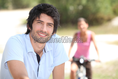 man riding bike outdoors and blurry