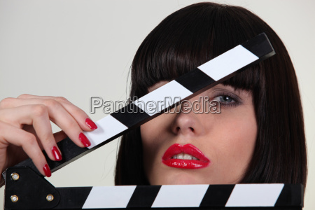 attractive woman with a film set