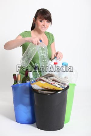 woman sorting recycling