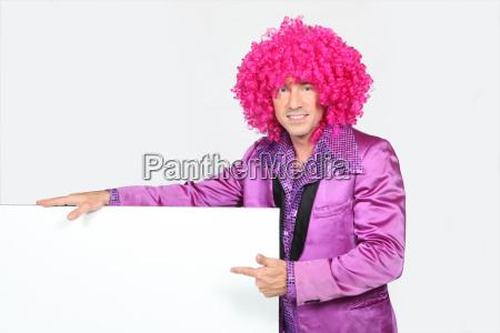 man in bright suite wearing wig