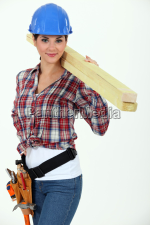 attractive woman carrying planks of wood