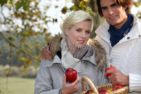 happy couple in the park gathering