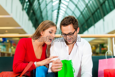 man and woman in department store