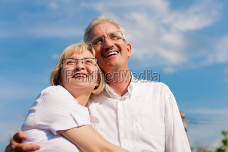 happy senior couple is looking into