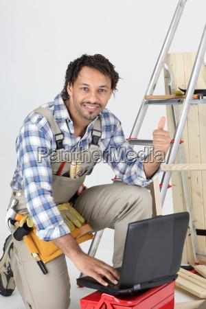 happy laborer using computer