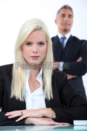 young blonde businesswoman with older man
