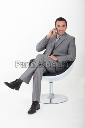 vorstand in einem drehstuhl auf einem