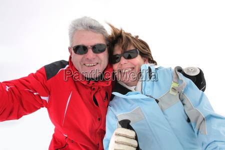 couple on snowy mountain