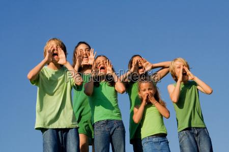 happy group of school kids shouting