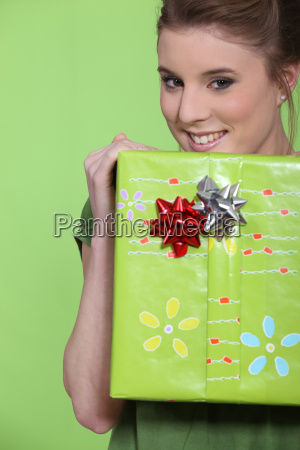 woman holding a big wrapped package