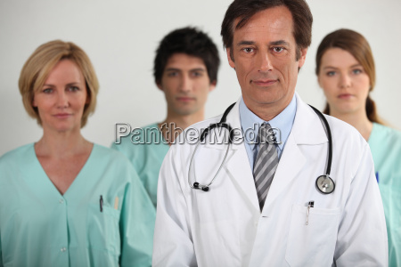 a doctor and three nurses behind