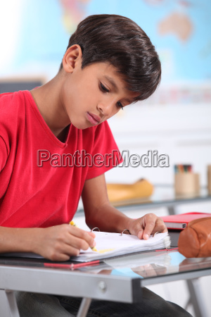 a young latino studying