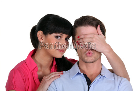 woman covering a man039s eyes