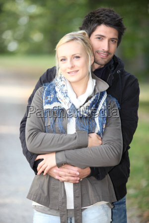 couple enjoying walk in park