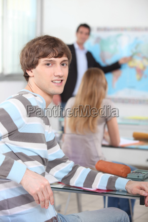 male student in a geography class