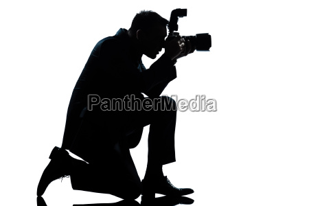 silhouette mann kniend fotograf