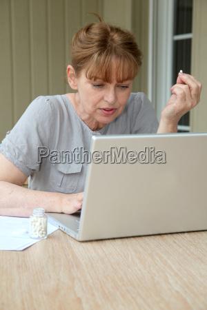 senior woman checking medical information on