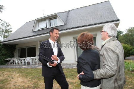 real estate agent with senior couple