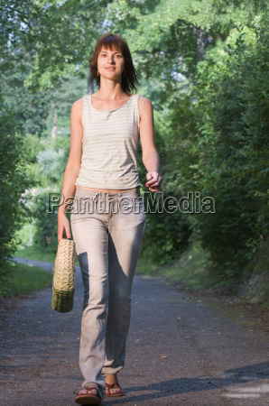 young lady on the footpath